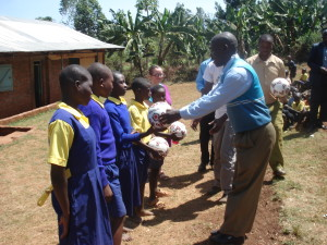 Leaders at Josiah's school receive soccer balls